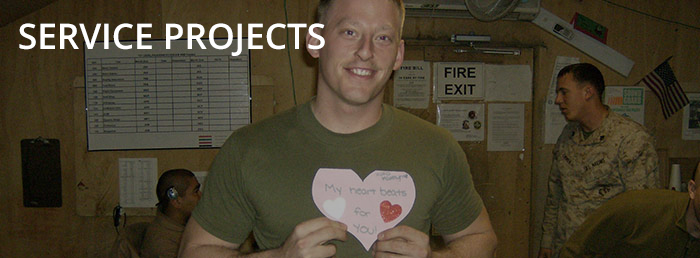 An active duty soldier holds a valentine sent from ESA members through the Hope For Heroes Program